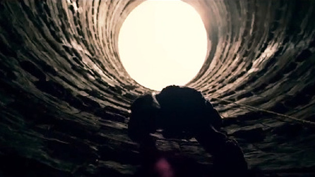 Bruce Climbing out fo the Hole